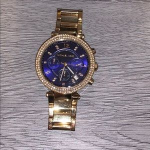 Gold and navy Michael kors watch